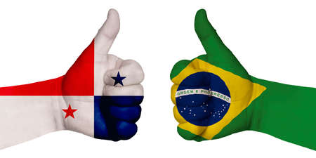 Photo for Politics and finance concept. Two hands with a raised finger. They portray the gesture class, managed to negotiate. On the hands of the image of the flags of the countries, Brazil and Panama - Royalty Free Image