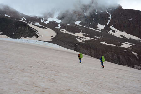 Two men go to the end of the glacier