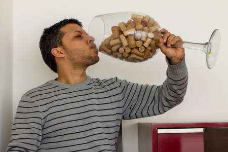 Man drinking from a very large cup