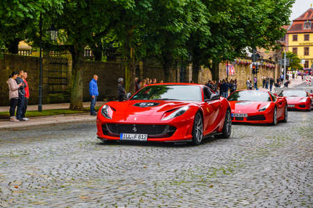 GERMANY, FULDA - JUL 2019: red FERRARI 812 SUPERFAST coupe Type F152M is a front mid-engine, rear-wheel-drive grand tourer produced by Italian sports car manufacturer Ferrari that made its debut at the 2017 Geneva Motor Show. The 812 Superfast is the succ
