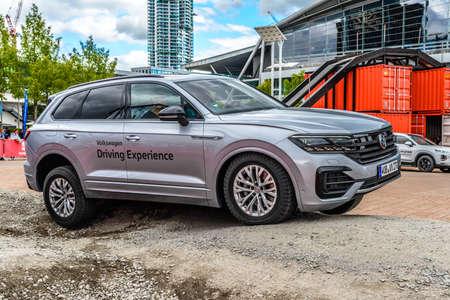 FRANKFURT, GERMANY - SEPT 2019: silver gray VOKLSWAGEN VW TOUAREG III 3 CR on test site, IAA International Motor Show Auto Exhibtion.