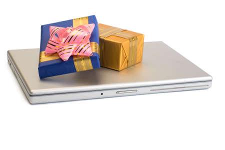 Photo pour a photo of some gift boxes over laptop - image libre de droit