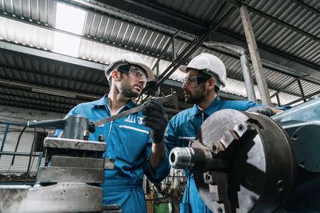 Foto für Engineer men wearing uniform safety in factory working machine lathe metal. - Lizenzfreies Bild