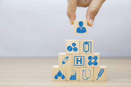 Photo for Medical and Health icons on wooden block planning for health care concept. - Royalty Free Image