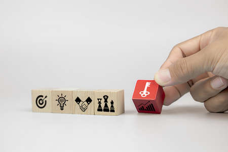 Photo pour Business man hand choose cube wooden toy blog with the key on business strategy icon of strategic plannig and organization management for success and growth concepts. - image libre de droit