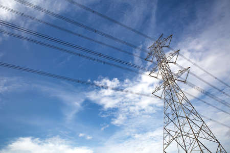 Photo for High-voltage transmission tower and wiring cable with sky background. - Royalty Free Image