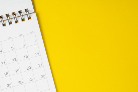 Photo pour White clean calendar on solid yellow background with copy space, business meeting schedule, travel planning or project milestone and reminder concept. - image libre de droit