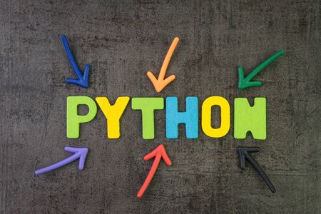 Foto de Python modern programming language for software development or application concept, multi color arrows pointing to the word Python at the center of black cement chalkboard wall. - Imagen libre de derechos