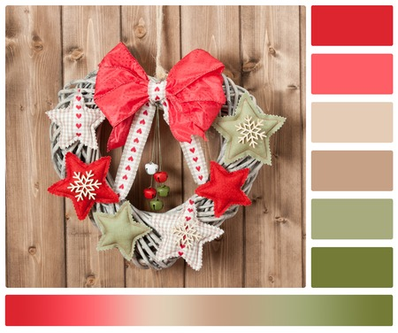 Christmas Wreath Decorated With Handmade Textile Stars And Bells Garland. Wooden Background. Palette With Complimentary Colour Swatches