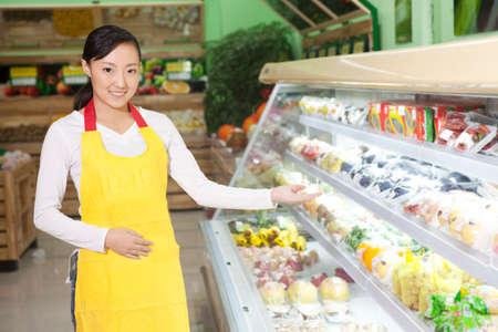Foto für A young shop assistant - Lizenzfreies Bild