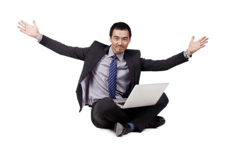 Photo for Young Businessman using laptop - Royalty Free Image