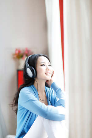 Photo for Fashion young woman wearing headset, listen to music - Royalty Free Image