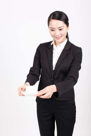 A business woman holding a coffee cup high quality photo