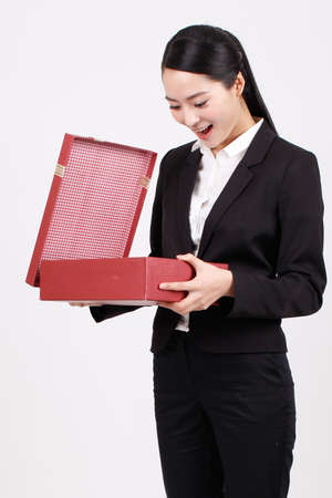 A business woman carrying a gift box high quality photo