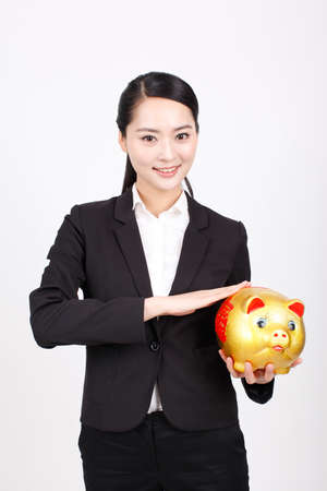 A business woman carrying a piggy bank high quality photo