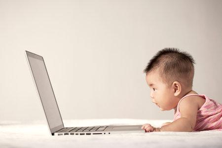 Photo pour A baby and a computer high quality photo - image libre de droit