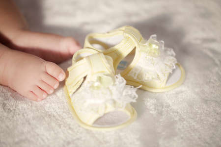Photo for Baby feet and booties high quality photo - Royalty Free Image