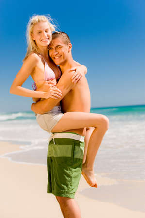 A couple on holiday at a beautiful beach