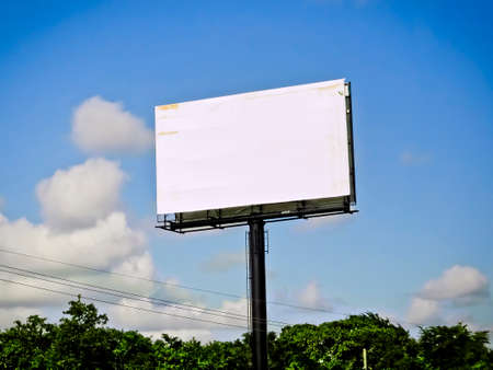 Photo pour Blank White Billboard with Blue Sky Clouds and Trees - image libre de droit