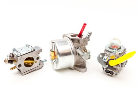 Photo pour Three different carburateurs for two stroke engines isolated on white - image libre de droit