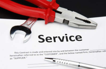 service contract agreement with pen, wrench and nipper
