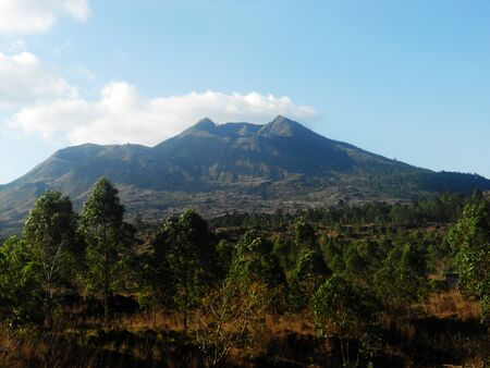 View of Balinese landscape with a volcano in the distance