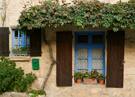 Windows od old traditional house in village of Cucuron, French Provence