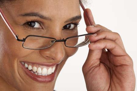 Photo pour Closeup of young woman wearing glasses. Horizontally framed shot. - image libre de droit