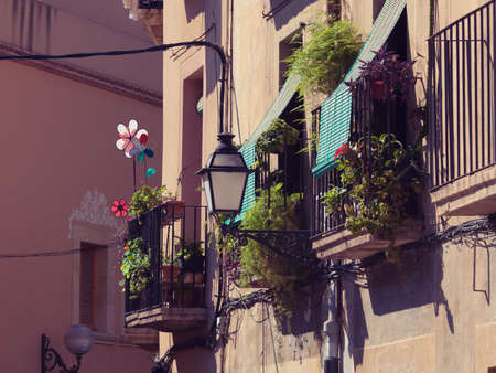 Balconies with flowers and pinwheels