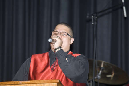 Bronx, NY - April 9: Pentecostal Christian singer Hector Delgado sings during event held at Lehman High School. Taken April 9th, 2011 in the County of the Bronx, NY.