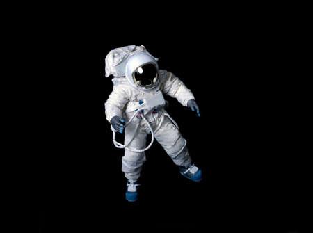 Photo pour Astronaut wearing a pressure suit against a black background. - image libre de droit