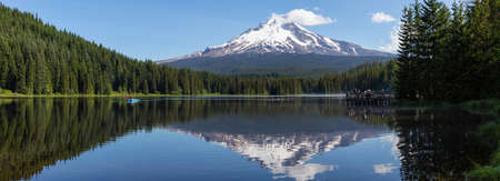 Beautiful Landscape View of a Lake with Mt Hood in the background during a sunny summer day. Taken from Trillium Lake, Mt. Hood National Forest, Oregon, United States of America.