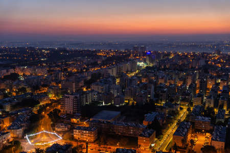 Photo pour Aerial view of a residential neighborhood in a city during a vibrant and colorful sunrise. Taken in Netanya, Center District, Israel. - image libre de droit