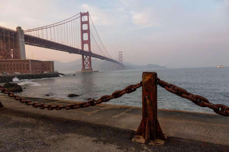 Beautiful view of Golden Gate Bridge during a cloudy sunset. Taken in San Francisco, California, United States.
