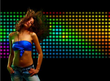 Beautiful young woman dancing in the nightclub