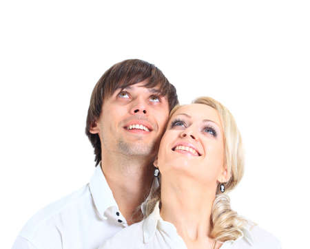 Couple having embraced look afar on a white background