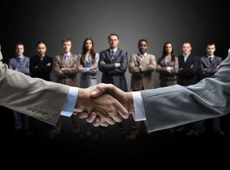 Foto de handshake isolated on business background  - Imagen libre de derechos
