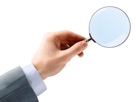 Magnifying glass in hand isolated over white background