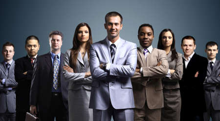 Photo pour business team formed of young businessmen standing over a dark background  - image libre de droit