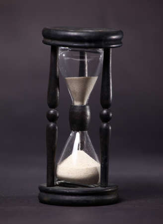Sand-glass with flowing sand took close