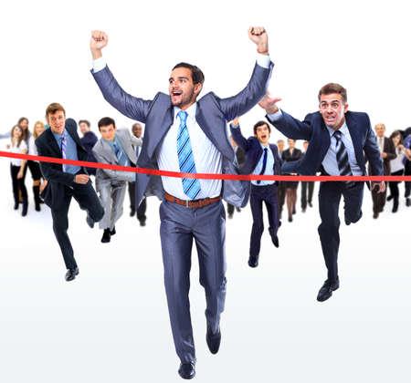 Photo pour Happy businessman running through finishing line - image libre de droit