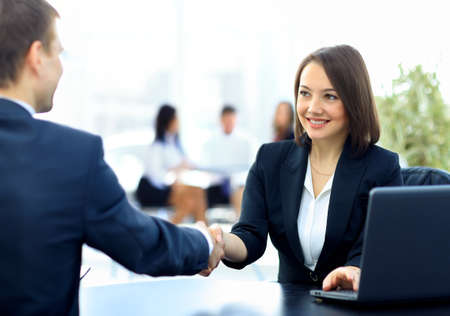 Photo pour Two professional business people shaking hands - image libre de droit
