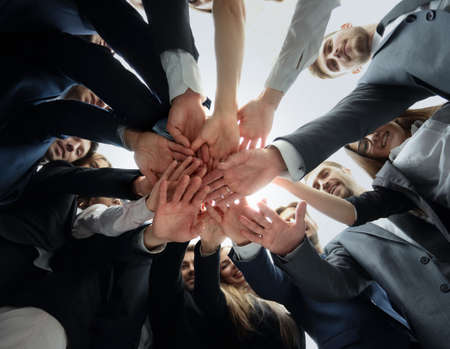 Photo for Large business team showing unity with their hands together - Royalty Free Image