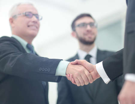 Closeup of handshake as a sign of successful cooperation and interest