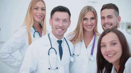 Cheerful team of doctors and interns make selfie
