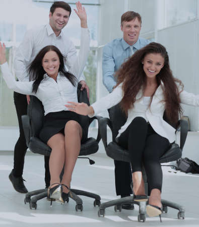 friendly business team with their hands up and enjoying the succ