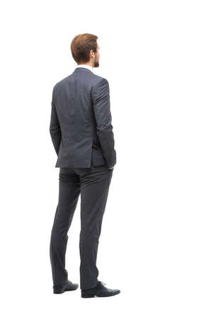 Photo pour rear view . businessman looking at copy space - image libre de droit