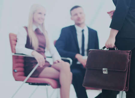 Close up portrait of a business woman  with briefcase