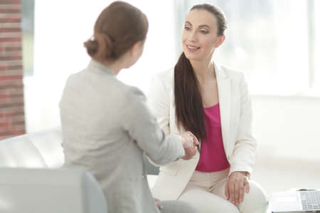 handshake business woman with a client