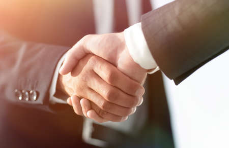 Photo pour Business men giving a handshake. Business concept - image libre de droit